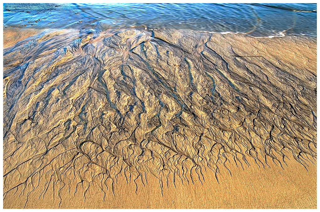 Beach at Baja Ca. As the tide withdraws, it leaves grooves in the sand creating a beautiful design.