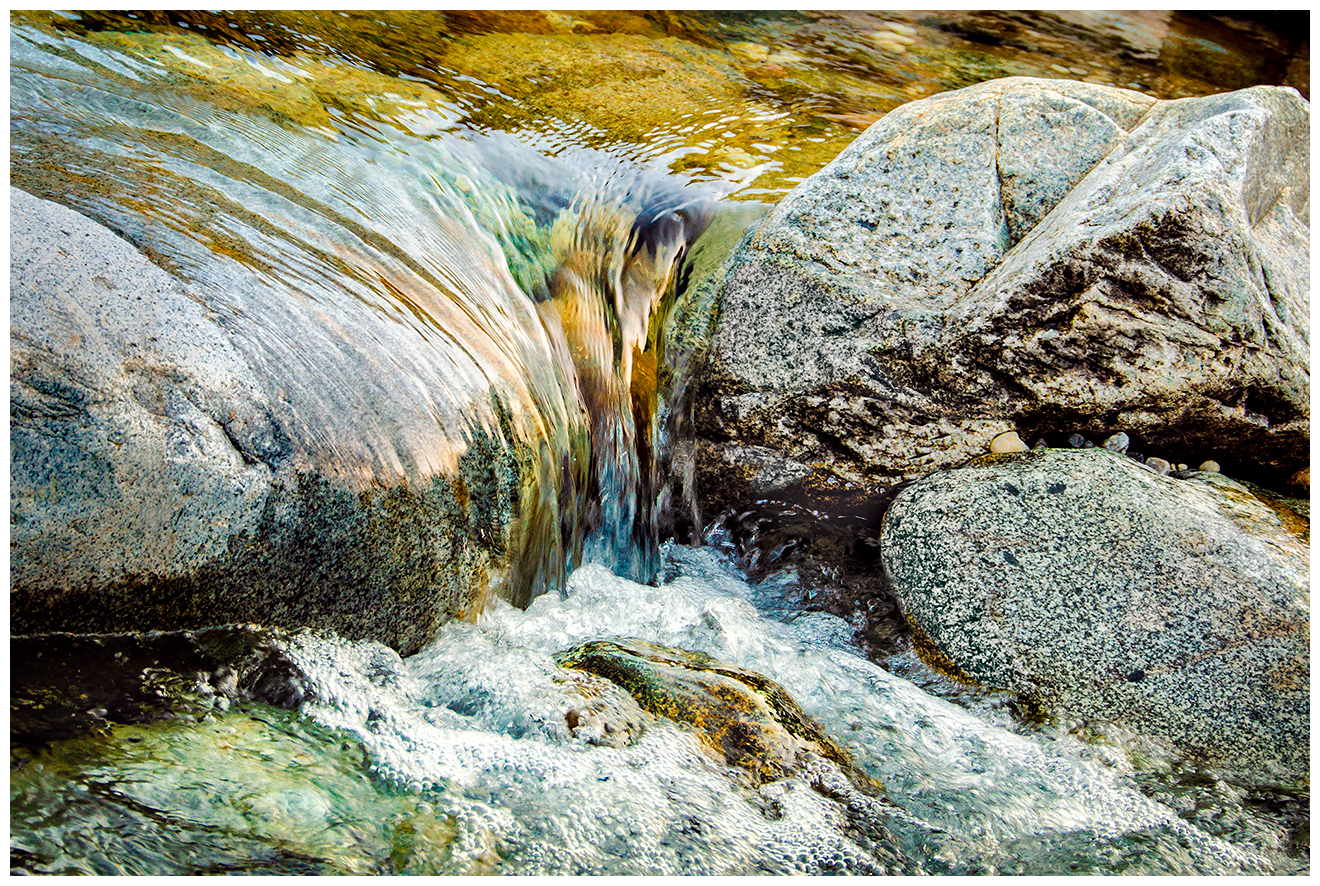 River water flows over rocks in the Yuba River