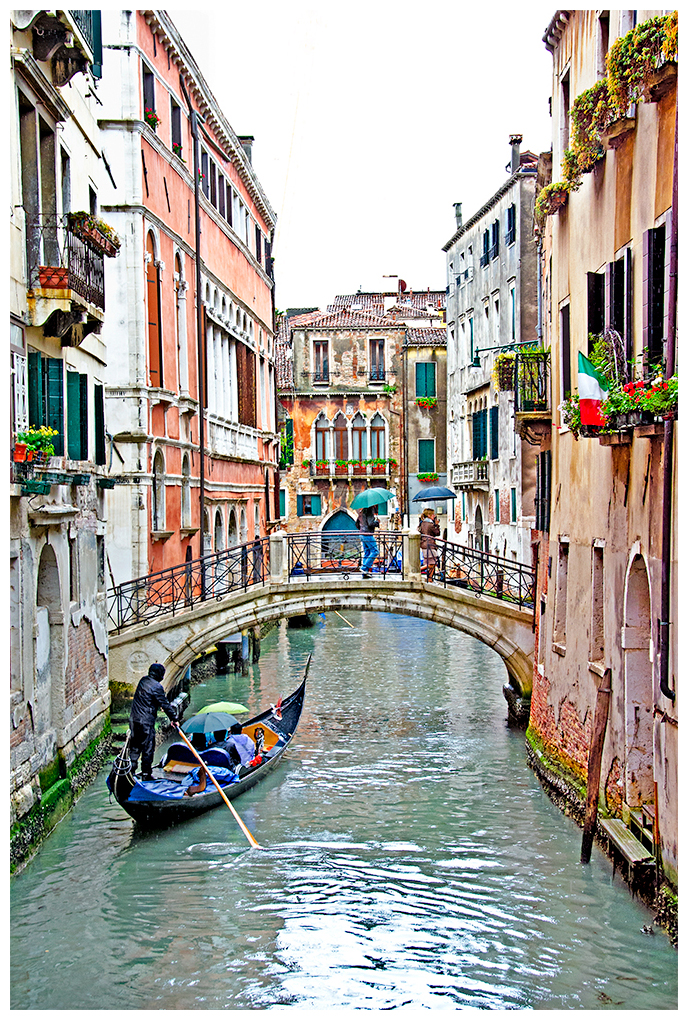Gondoliers in Venice on a rainy day