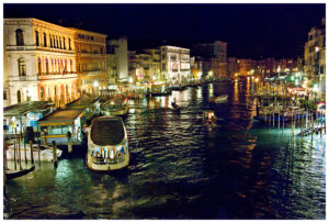 View of the Grand Canal from the Rialto bridge at night.