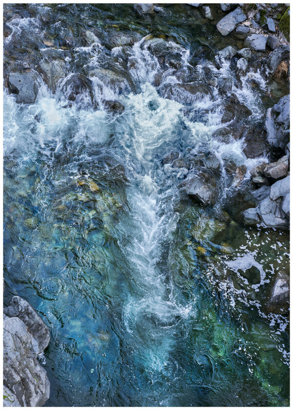 Swirling water forms fleeting images in the Yuba River