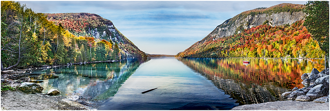 Lake Willoughby surrounded  by color aspen.