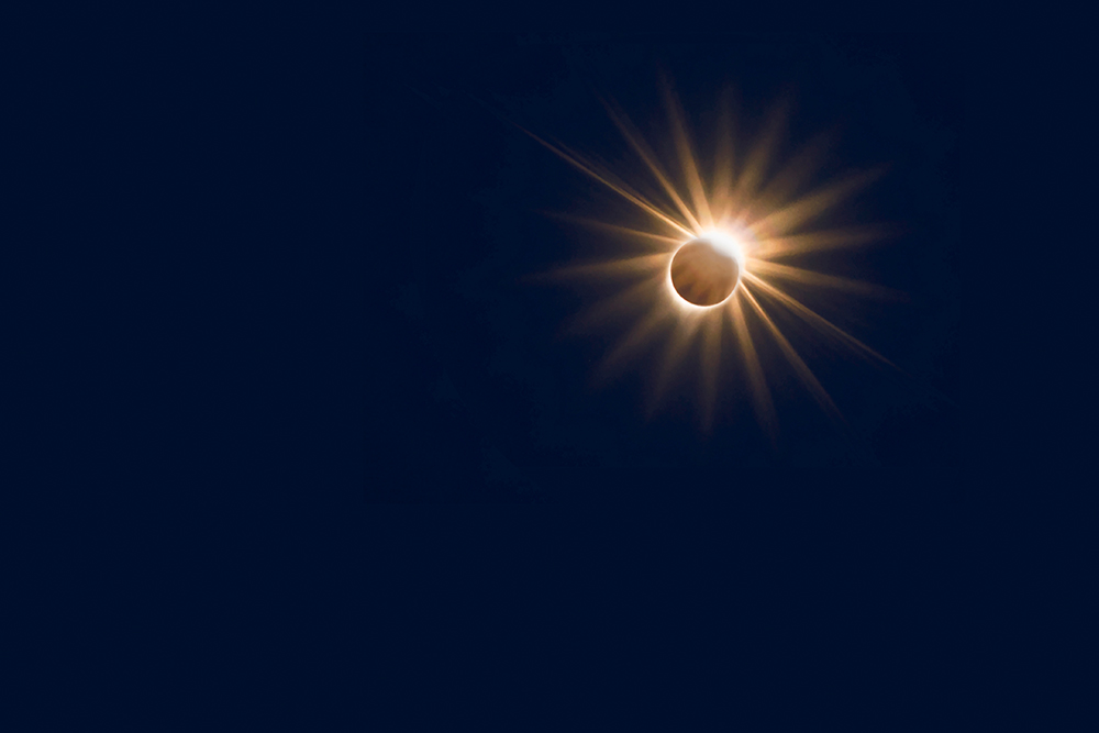 Flash of light from the corona of a total eclipse the looks like a diamond ring